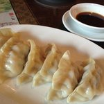 Yummy steamed dumplings with ginger sauce appetizer