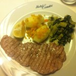 grilled veal steak with buttery kale and small roasted potatoes