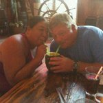 friends sharing a piña colada (served in whole pineapple)