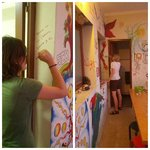 Painting the hostel walls with other guests