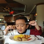 son enjoying his breakfast meal