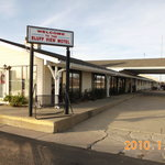 The exterior and parking lot of Bluff View Motel