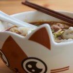 Dumplings in a Cat shaped bowl. Cute.