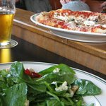 Beer, pizza, salad: you can't go wrong.