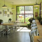 Bright, sunny seating area with local art exhibits