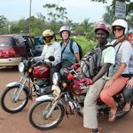 Here's us and Ricky and Robert on a boda tour of Kampala. So much fun!