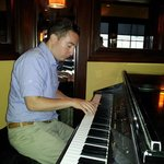 Skilled pianist entertains patrons during dinner