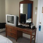 Dresser, tea/coffee maker, TV with cable