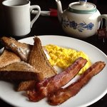 Tasty 2-2-2 meal with scrambled eggs, toast, and bacon for only $4.95