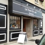 Exterior entrance of Let Them Eat Cake, next to Albert Street Inn; 10% discount and wi-fi for ho