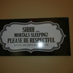 sign inside hotel hallways by rooms