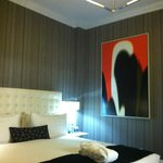 A good night's stay in a comfy bed under a cube chandelier and artwork with blurred lines...