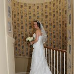 Bride photo in hallway via rooms to the reception