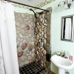 Experience the unique stone waterfall shower