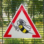A friendly warning sign on the island site! (no worries; no bees were seen during our visit!)