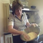 Imelda showing us how to make scones and tart