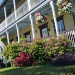 Hanging baskets and blooming bougainvilla