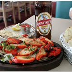 Tandoori chicken kabob with nan and beer!