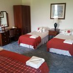 Our room 207 en suite king size bed & 2 singles  given this room for only the two of us ...resul