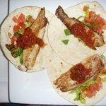 Yummy fish tacos, salsa added