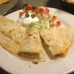 """This """"half-quesadilla"""" was loaded with creamy queso blanco, cheddar, and grilled chicken."""