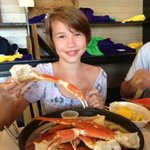 Granddaughter with plate of crab legs.