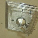Missing screw in shower fixture