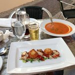 tomato rosemary soup and scallop appetizer.