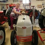 "Here I am (4'11"") with a tractor just MY size!  Who knew?"