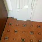 Dusty carpet in the corner