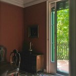 Lovely Dining Room with French dors leading out to small balcony overlooking a square across the