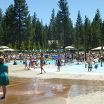 Outdoor pools (seasonal) with 2 water slides in background