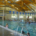 2 pools inside - deeper for diving (no board), lap swim.  There was a water volleyball and baske