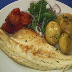 Wild Sea Bass with Roast Balsamic Cherry Tomatoes, Crushed New Potatoes and a Rocket Salad