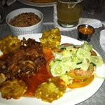 tasty traditional haitian food and rum sour