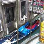 Delicate bridge to Piazza San Marco. Taxi stop under window. Brandy from Ukraine