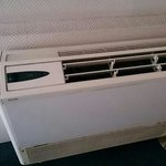 old broken air conditioning unit