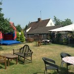 Plenty of seating in the garden, complete with bouncy castle!
