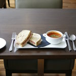Tomato soup and sandwich on bloomer bread