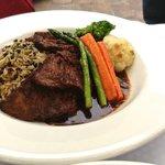 Braised Boneless Short Rib: red wine reduction, succotash vegetable medley, grilled polenta