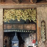 Old beams hung with horse brasses and hops