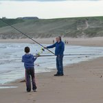 Fishing on the beach beside Cruden Bay Golf Course