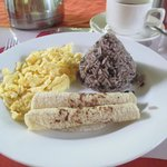 The main course of one of my breakfasts. Note the Gallo Pinto in the shape of Arenal!