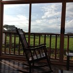 My reading chair overlooking field and beach at Samara Inn