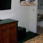 "Flatscreen 40"" LED TV over cabinet & refrigerator (right of cabinet)"