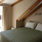 The upstairs bedroom & balcony