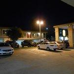 Well lit parking lot.