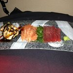 sashimi platter: fresh tuna,salmon, Asian squid over fresh avocado! and the chef makes 2/3 sauce