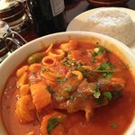 Seafood in red sauce and rice.