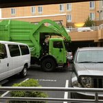 Dumpster truck right outside room